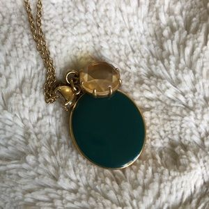 Long emerald green locket and jewels necklace